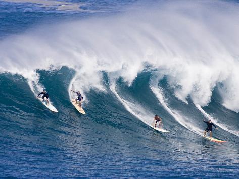 Surfers Ride a Wave at Waimea Beach on the North Shore of Oahu, Hawaii Photographic Print