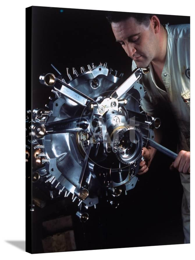 Man Working on Power Section of 'Wasp' Airplane Engine at Pratt and Whitney  Aircraft Parts Factory
