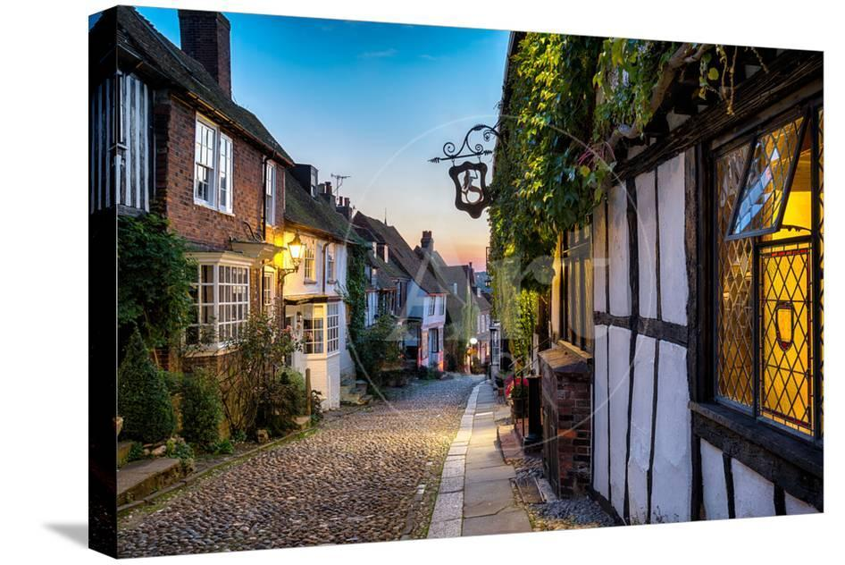 Dusk At A Row Of Beautiful Old Houses On A Cobbled Street In Rye