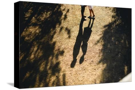 Beautiful Couple Walking in the Forest Stretched Canvas Print
