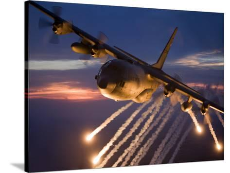 a c 130 hercules releases flares during a mission over kansas