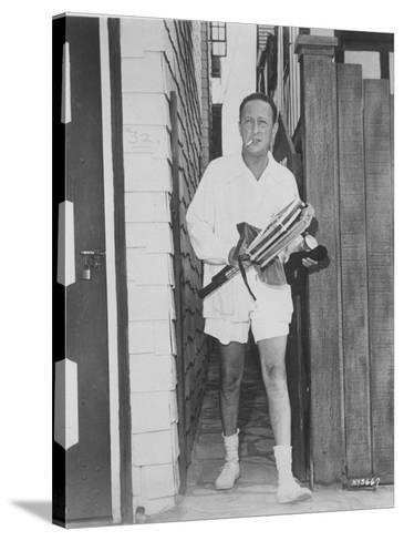 Violin Virtuoso Jascha Heifetz in Tennis Clothes, with Rackets in Hand and  Cigarette in Mouth