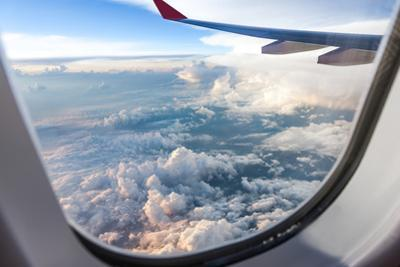 Clouds and Sky as Seen Through Window of an Aircraft by 06photo