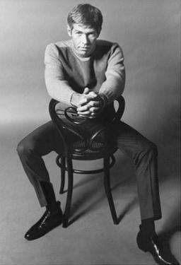 10 Years - People; Actor James Coburn, Seated Backwards on a Chair by 0 0