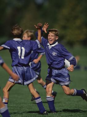 11 Year Old Boys Soccer Player Celebates a Goal