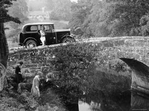 1930 Triumph Super 7 on a Stone Bridge in Rural England, 1930's