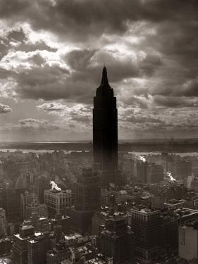 1930s-1940s Empire State Building Silhouetted Against High Gathering Storm Clouds Covering NYC
