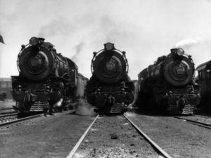 1930s Head-On Shot of Three Steam Engine Train Locomotives on Tracks