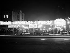 1930s New and Used Car Lot at Night Automobile Sales, Greenwich Village