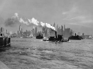 1933 Steam Engine Tug Boat and Staten Island Ferry Boats on Hudson River Against Manhattan