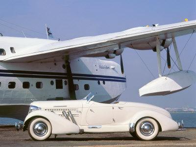 https://imgc.allpostersimages.com/img/posters/1935-auburn-851-speedster-with-sunderland-flying-boat_u-L-Q10VZK30.jpg?p=0