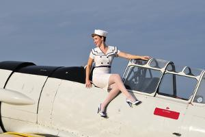 1940's Style Pin-Up Girl Sitting Outside the Cockpot of a T-6 Texan