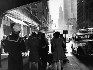 1940s Grand Central Station Men and Women Pedestrians a Sailor in Uniform Taxi and Stores 42nd St
