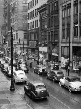 1940s Rainy Day on Chestnut Street Philadelphia,, PA Cars Pedestrians Storefronts