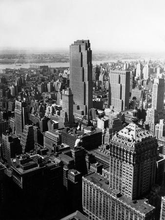 https://imgc.allpostersimages.com/img/posters/1950s-aerial-view-of-rockefeller-center-radio-city-in-middle-grand-central-station_u-L-Q1BQKNE0.jpg?p=0