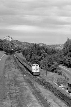 1950s Overhead View of Streamlined Front Cab Diesel Locomotive Passenger Railroad Train Passing