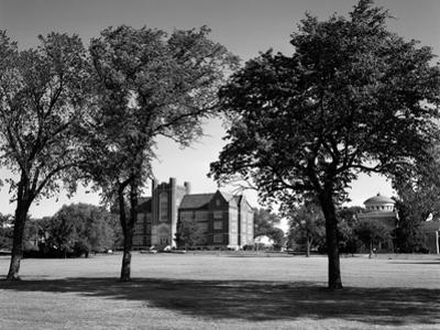 1970s Campus of Emporia College in Kansas with Brick Buildings Nestled Among Trees