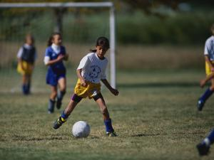 8 Year Old Girl in Action Durring Soccer Game, Lakewood, Colorado, USA