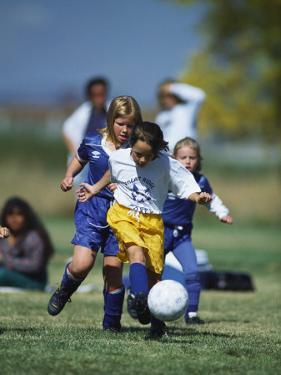 8 Year Old Girls in Action Durring Soccer Game, Lakewood, Colorado, USA