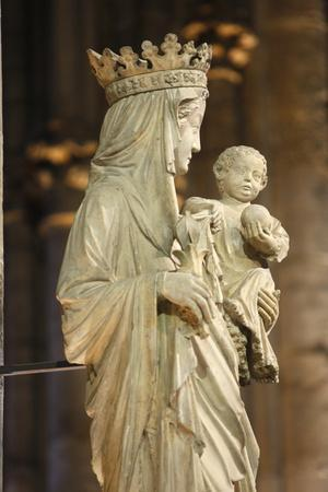 https://imgc.allpostersimages.com/img/posters/a-14th-century-virgin-and-child-statue-in-notre-dame-cathedral-france_u-L-Q1GYMRU0.jpg?artPerspective=n