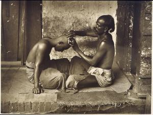 A Barber at Work in Ceylon (Sri Lanka)