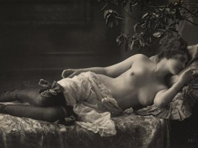 A Barebreasted Young Woman Lying Down, Wearing Shoes and Lingerie