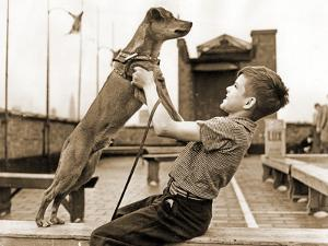 """A Boy and His Dog Brownie, Winner of """"The Biggest Tramp""""Competition, New York 1938"""