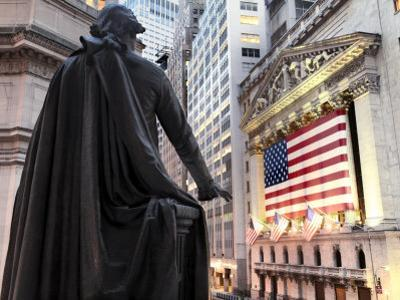 A bronze statue of George Washington and the New York Stock Exchange