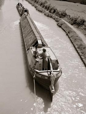 A Canal Boat Transporting Cargo Along the The Narrow Waterway Near Kings Langley, Hertfordshire