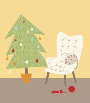 A Cat on a Chair Next to a Christmas Tree