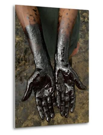 A Chapopero, Literally the Tar Man, Shows His Oil-Covered Hands