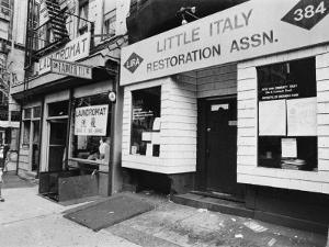 A Chinese Laundromat is Seen Next Door to the Offices of the Little Italy Restoration Association