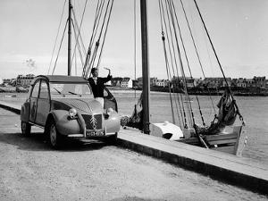 A Citroën 2CV on the Quay at a Harbour, C1957