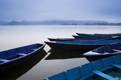 https://imgc.allpostersimages.com/img/posters/a-cold-front-brings-a-low-lying-fog-above-phewa-lake-next-to-pokhara-nepal_u-L-Q10TGCU0.jpg?p=0