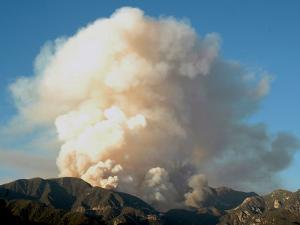 A Column of Smoke Rises from the Angeles National Forest Pines Fire