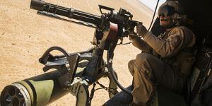 A Crew Chief Mounts a M134 Minigun
