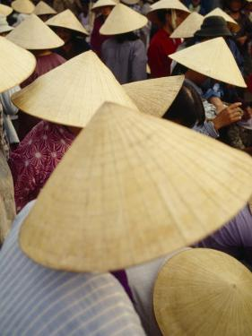A Crowd of People in Conical Straw Hats at a Wet Market in Hoi An