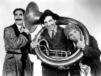 https://imgc.allpostersimages.com/img/posters/a-day-at-the-races-groucho-marx-chico-marx-harpo-marx-1937_u-L-P6QFS70.jpg?artPerspective=n