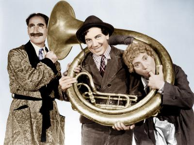 https://imgc.allpostersimages.com/img/posters/a-day-at-the-races-groucho-marx-chico-marx-harpo-marx-1937_u-L-PJXVLW0.jpg?artPerspective=n
