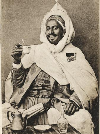 A Decorated Moroccan Tribal Chief Enjoying a Cup of Coffee