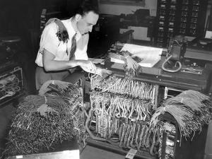 A Engineer Works on a IBM Computer Used to Administer Gl Insurance Dividend for Millions of Vets