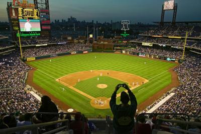A fan with a digital camera taking a panoramic image of Citizens Bank Park, Philadelphia, PA, on...