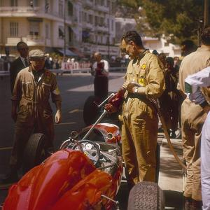 A Ferrari Team Member Filling a Car with Fuel, Monaco Grand Prix, Monte Carlo, 1963