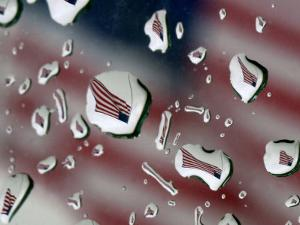 A Flag at a Lawrence, Kan., Restaurant is Refracted in Rain Drops on a Car Window