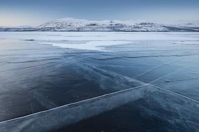 https://imgc.allpostersimages.com/img/posters/a-frozen-lake-so-clear-its-possible-to-see-through-the-ice-near-absiko-sweden_u-L-PWFIGB0.jpg?p=0