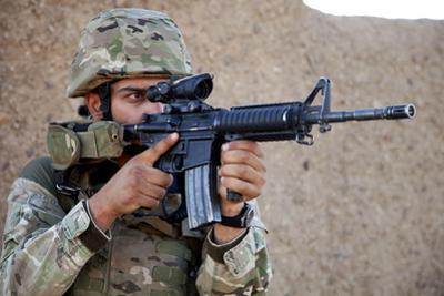 A Georgian Army Soldier Surveys the Surrounding Area