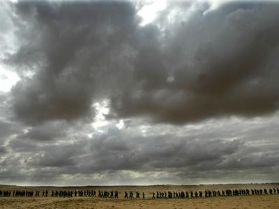 https://imgc.allpostersimages.com/img/posters/a-grey-sky-hangs-over-israeli-soldiers-as-they-march-near-the-tseelim-army-base_u-L-Q10ORB70.jpg?p=0
