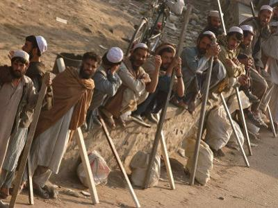 A Group of Afghan Construction Daily Workers Wait to be Hired