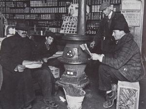 A Group of Men around a Stove in an American Store, C.1910