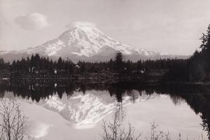 Snow-Capped Mount Rainier Reflects on Spanaway Lake by A. H. Barnes